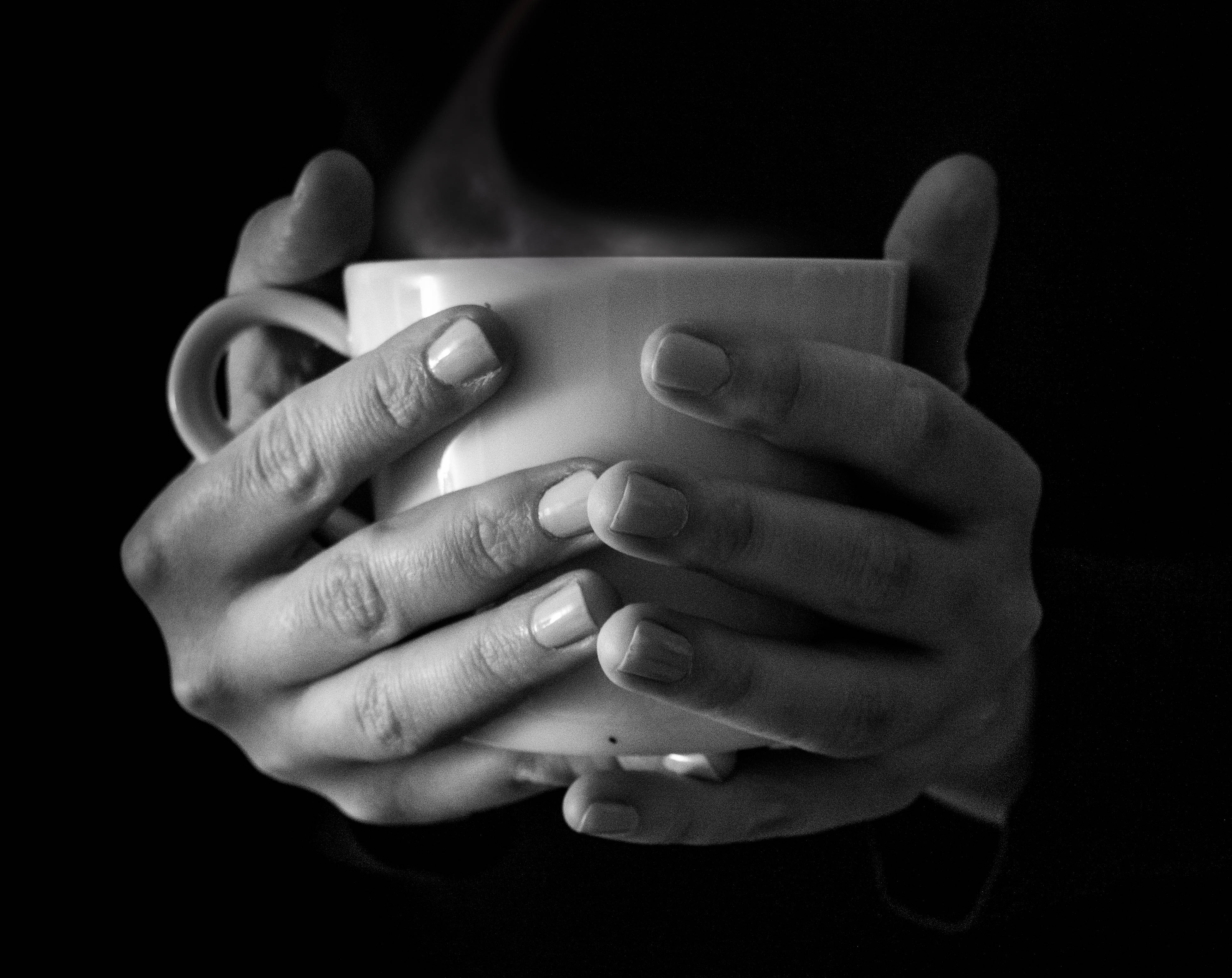 Hands holding a cup of tea