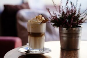 picture of a cappuccino next to a plant