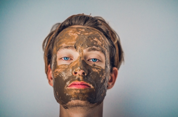 Young man with a face mask for acne