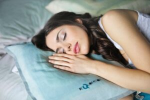 Woman sleeping after using kratom in the evening