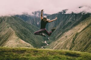 A person jumping in nature after taking kratom and matcha